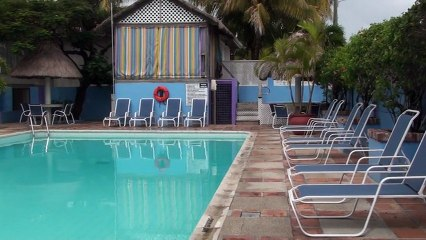 """""""Moving to Belize"""" conference hotel pool"""