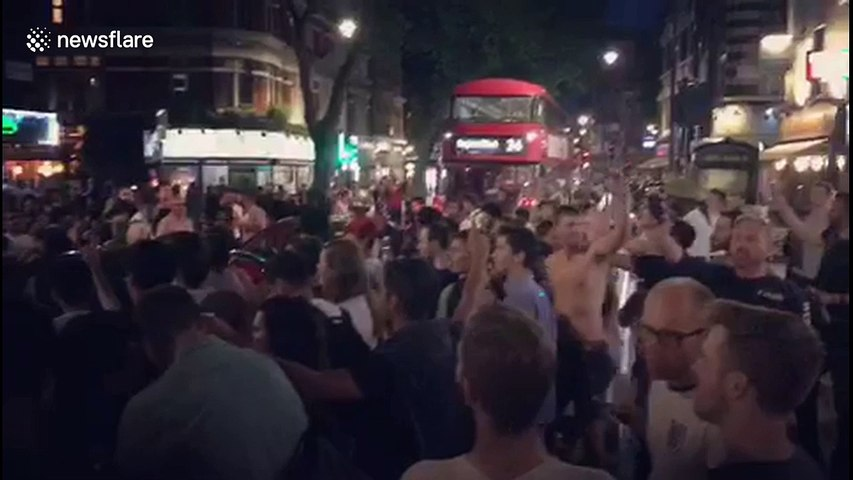 Shirtless fan in London jumps atop car after last-16 win against Colombia