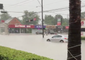 Debris, Floodwaters Wash Over Houston Streets, Businesses