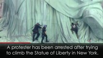 Protester climbs the New York Statue of Liberty!