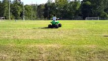 Having Fun Playing With His New Powered Ride On Pacific Sport ATV 12V