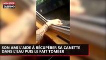 Son ami l'aide à récupérer une canette dans l'eau... puis le fait tomber ! (Vidéo)