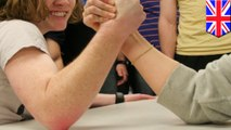A young woman breaks her arm during a friendly arm wrestle