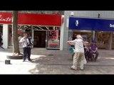 Elderly couple lovingly dance to a busker in Wolverhampton city centre