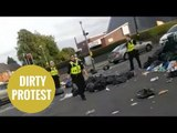 Police called after youths block road off with uncollected rubbish