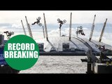 Travis Pastrana performs the first motorcycle backflip between two barges