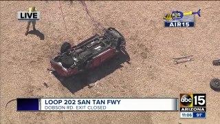 Fiery rollover shuts down freeway exit