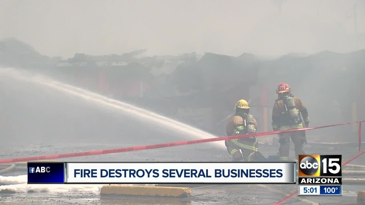 Fire destroys several businesses at Phoenix strip mall threatened homes