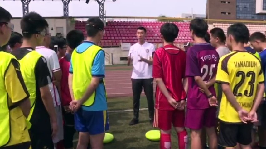 A special PE session at Nankai University coached by the Chinese national team goalie Zhang Lu, captain of the Chinese Super League's Tianjin Quanjian. | Godialy.com