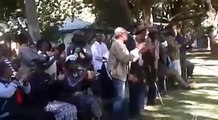 Members of the National Patriotic Front led by Ambrose Mutinhiri singing and dancing at a meeting in Harare, a few hours after the party's faction led by Eunice