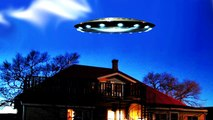 UFO sighting Rare scenes of a UFO flying saucer is near the roof of and observation house