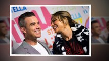 Robbie Williams and glamorous wife Ayda Field can't contain their giggles as they cosy up to each ot