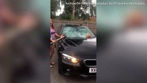 Angry wife takes a sledgehammer to her husband's BMW when she discovered he had been cheating on her