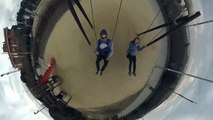 Parents with baby on playground having fun on swings,Insta360 One