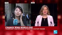 Fans wait for French players at Hotel de Crillon