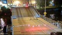 Footage shows cyclist fall into gap of rising bridge