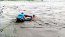 NDRF personnel rescue people stranded in flooded river | OneIndia News