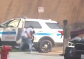 Bystanders Help Police Officer After Crash in Unfiltered View of Police-Community Relations in Chicago