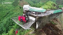Video shows truck half-dangling off cliff after driver loses control