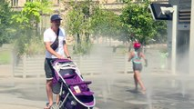 Parisians, tourists turn to fountains for summer relief