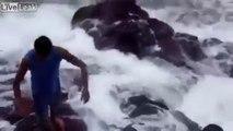 Miraculé - emporté par les vagues dans les rochers !
