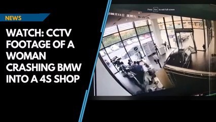 Watch: CCTV footage of a woman crashing BMW into a 4S shop