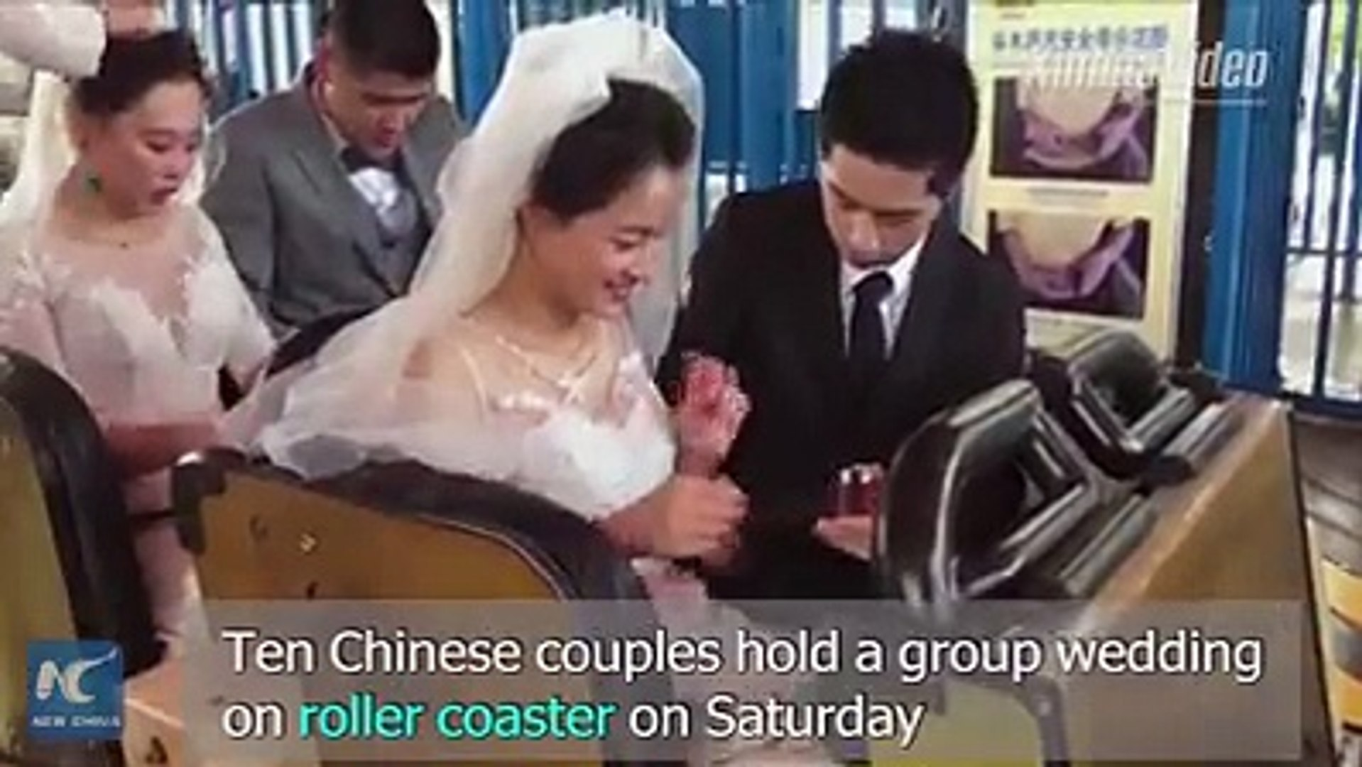 A unique group wedding ceremony was held on a wooden roller coaster at a Shanghai's amusement p