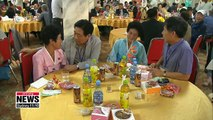Separated families from the two Koreas share memories of the past during their group reunion