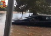 Italian Police Rescue Family From Car Trapped in Floodwater in Taranto