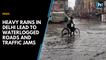 Heavy rains in Delhi lead to waterlogged roads and traffic jams
