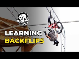 Learning how to backflip my mountain bike | Featuring Skills with Phil