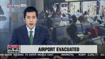 Passengers and workers evacuated from Japan's Kansai International Airport after being stranded for a day