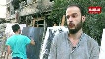 فنانون سوريون وفلسطينيون يرسمون الدمار في مخيم اليرموك
