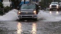 Drivers brave floods in Wilmington, North Carolina
