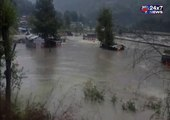 Vacant trucks  gets washed away into the flooded Beas river in Manali HimachalPradesh