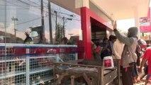 Indonesia quake victims loot shops amid food shortage