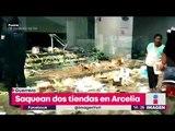 800 personas saquean 2 tiendas ¡hasta niños se meten a robar! | Noticias con Yuriria Sierra