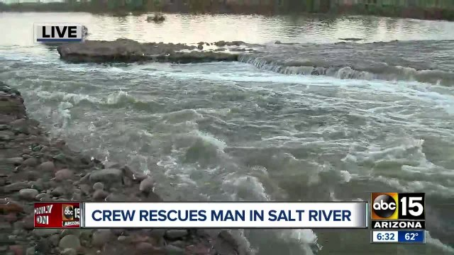 Fast-moving water traps man overnight in Phoenix
