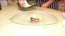 Ensalada de bonito curado, pepino, agua de tomate y polvo de olivas