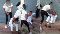 काला चश्मा पहनकर एक लड़की लाठियों से कर रही है युवक की पिटाई, वीडियो हुआ वायरल
