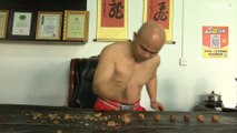 Record breaking Kung Fu master cracks nuts barehanded