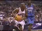 NBA BASKETBALL - Michael Jordan dunks on Tim Duncan