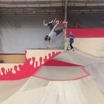 Skater Does 180 Degree Flip off Skateboard During Ramp Jump