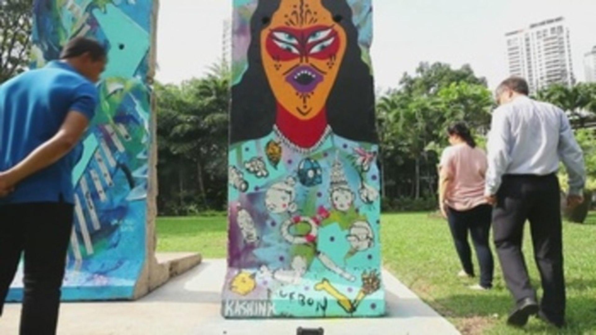 Bangkok exhibe dos segmentos del muro de Berlín renovados con arte callejero