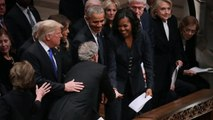 George W. Bush Slips Candy To Michelle Obama At Father's Funeral