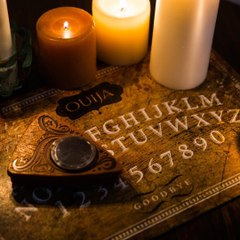 Here's a look at how the ouija board went from a tool used at séances to a Hasbro board game.