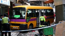 Four killed as Hong Kong schoolbus mounts pavement