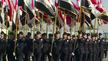 Iraqi forces hold military parade one year after IS defeat