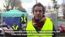 """Annonces de Macron: réactions de """"gilets jaunes"""""""