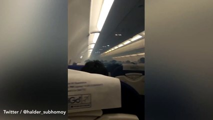 Passengers screaming as plane fills with SMOKE during flight in viral video